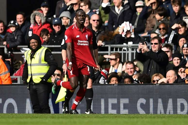 Mane celebrates yet another goal for Liverpool. AFP