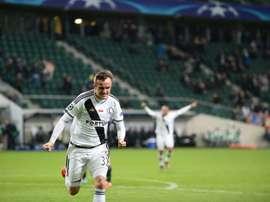 Radovic celebrates making it 2-2 after being 2-0 down. AFP