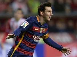 Barcelona's forward Lionel Messi celebrates after scoring a goal during the Spanish league football match Real Sporting de Gijon vs FC Barcelona at El Molinon stadium in Gijonon on February 17, 2016