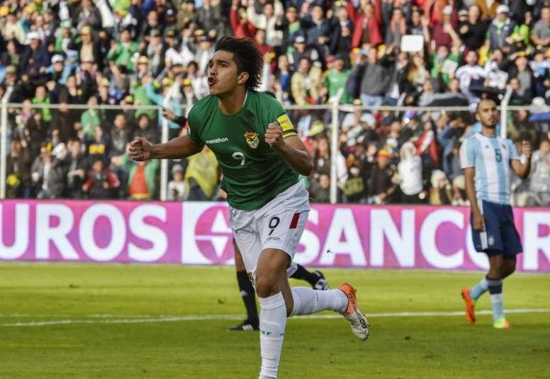 Bolivias forward Marcelo Martins celebrates after scoring against Argentina