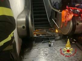 Wreckage of an escalator after it jammed at the metro station Repubblica in Rome. AFP