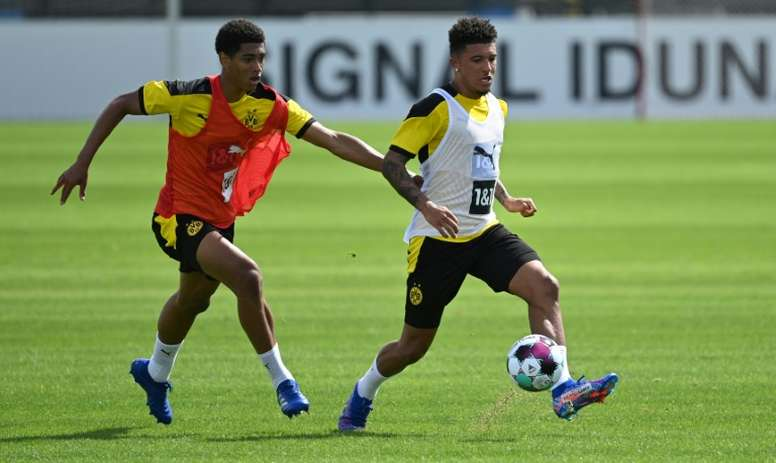 Sancho (R) has flown to Dortmund amid rumours over a move to Man Utd. AFP