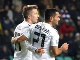 Gundogan (R) was the hero for Germany in Tallinn. AFP