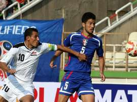 Younis Mahmoud (left) rescued a point for Iraq with a last-ditch penalty as the former Asian champions drew 1-1 with Vietnam in Hanoi