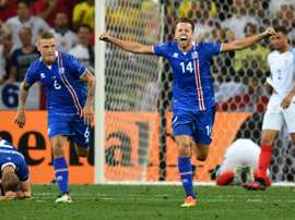 (L to R) Icelands defender Ragnar Sigurdsson and teammate Kari Arnason celebrate their teams 2-1 win in a Euro 2016 round of 16 football match against England at the Allianz Riviera stadium in Nice on June 27, 2016