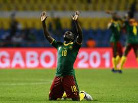 Cameroon's Robert Ndip Tambe celebrates at the end of their match against Guinea-Bissau. AFP