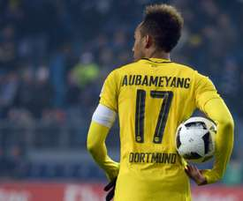 Dortmunds Pierre-Emerick Aubameyang holds the ball after scoring four times against Hamburg. AFP