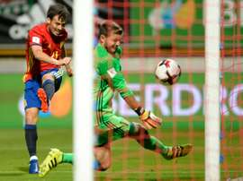 Spains midfielder David Silva shoots against Liechtensteins goalkeeper Peter Jehle on September 5, 2016