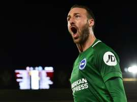 Glenn Murray converts late penalty to earn a point for Brighton at Saint Mary's. AFP