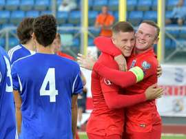 Englands Ross Barkley (C) celebrates with Wayne Rooney (R) after soring during a Euro 2016 qualifying football match against San Marino in Serravalle on September 5, 2015
