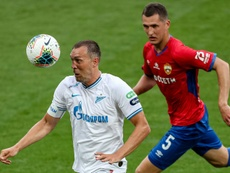 Artem Dzyuba (L) got two in Zenit's 2-4 win at Krasnodar. AFP