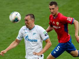 Artem Dzyuba (L) got two in Zenit's 2-4 win at Krasnodar. AFP