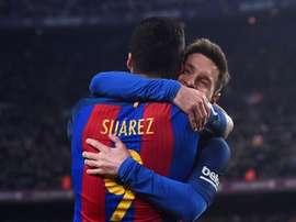 Les joueurs du FC Barcelone, Leo Messi et Luis Suarez célèbrent un but en Liga. AFP