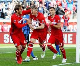 Bastian Schweinsteiger (C) of Chicago Fire celebrates after scoring a goal