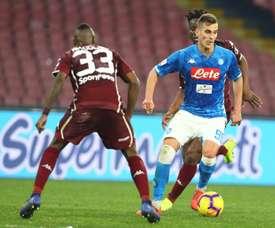 Polish striker Arkadiusz Milik missed chances as Napoli were held. AFP