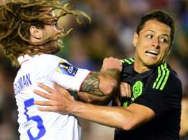 Javier Hernandez (R) of Mexico collides with Kyle Beckerman of the US during their CONCACAF Cup match at the Rose Bowl in Pasadena, California, on October 10, 2015