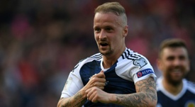 Griffiths is one of the more senior striking options for the Scotland national team .AFP