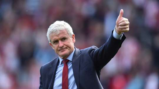Mark Hughes wants his squad to do more. AFP