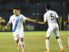 Guatamalas Rafael Morales (L) celebrates with teammate Moises Hernandez after scoring against USA in Guatemala City