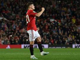 Daniel James scored the winning penalty to spare United's blushes v Rochdale. AFP
