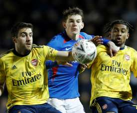 Sokratis (L) may leave Arsenal if he does not play more often. AFP