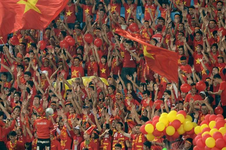 Vietnamese fans cheer on their team before the start of the Suzuki Cup semi-final 2nd leg match against Indonesia, at Hanois My Dinh stadium, on December 7, 2016