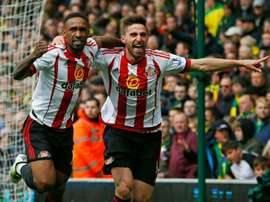 Borini (R) will be out for three months. AFP