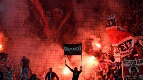 Volunteers and virtual beer: German fans take fight to virus. AFP