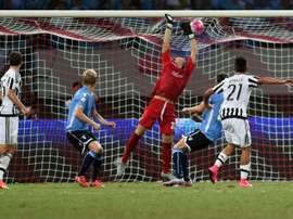 Paulo Dybala (left) scores Juventuss second goal during the Italian Super Cup final against Lazio in Shanghai on August 8, 2015