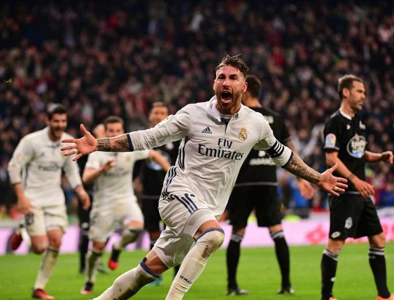 Real Madrids defender Sergio Ramos celebrates after scoring against Deportivo at the Santiago Bernabeu stadium in Madrid on December 10, 2016