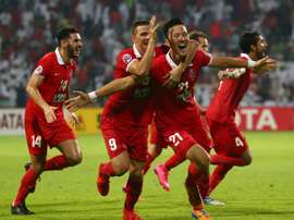 UAEs Al Ahli players celebrate after scoring a goal against Saudi Arabias Al Hilal during their AFC Champions League semi-final match in Dubai, on October 20, 2015