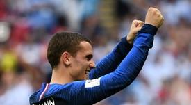 El Atlético le dio la enhorabuena a sus campeones. AFP