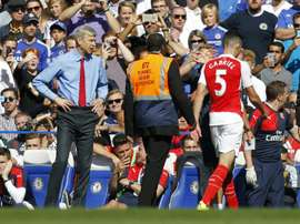Arsenals manager Arsene Wenger (L) reacts after the sending off of defender Gabriel (R) during the English Premier League football match against Chelsea at Stamford Bridge in London on September 19, 2015