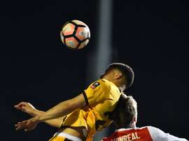 Sutton United's striker Maxime Biamou (L) vies with Arsenal's defender Nacho Monreal. AFP