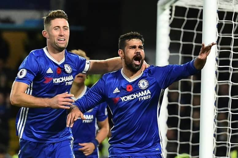 Chelseas Diego Costa (R) celebrates with teammate Gary Cahill after scoring a goal during an English Premier League match against Everton, at Stamford Bridge in London, on November 5, 2016