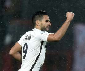 Monacos Colombian forward Radamel Falcao raises his fist as he celebrates after scoring during the French L1 football match between Lorient and Monaco on November 18, 2016 at the Moustoir stadium of Lorient, western France