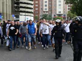Legia Warsaw fans are escorted by Spanish police into the stadium. AFP