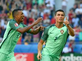 Portugal forward Cristiano Ronaldo (R) celebrates after scoring a goal against Hungary. BeSoccer