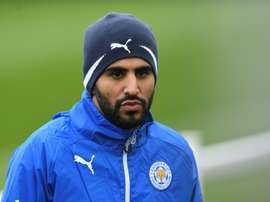 Wes Morgan says that Riyad Mahrez is continuing to work hard amid talk of a move to Roma. AFP