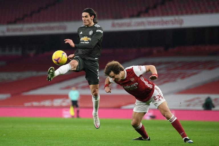 Man Utd stumble in Arsenal stalemate, Man City extend leading edge