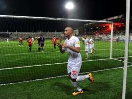 Tunisias Khazri Wahbi (C) celebrates after scoring a penalty against Libya. AFP
