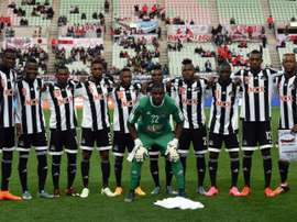 Players of TP Mazembe pose on the pitch prior to their Club World Cup fifth place play-off match against Club America in December 2015