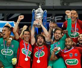Maxwell lifted his final trophy for PSG. AFP