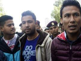 Nepalese footballers Sagar Thapa (R), Ritesh Thapa (C) and Sandip Rai (L) arrive at a Special Court in Kathmandu on October 27, 2015 as part of the match-fixing scandal that has hit the national team