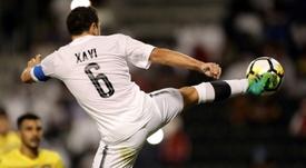 Xavi se formera au Qatar. AFP