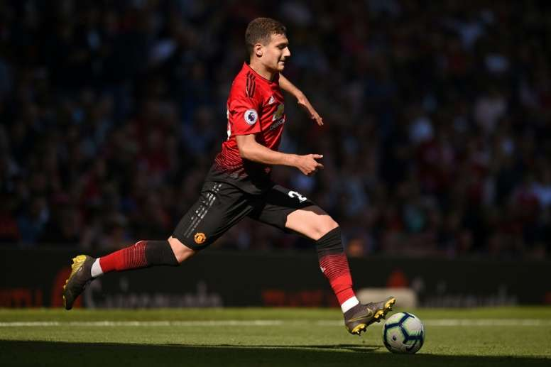 Man United's Dalot visits 'Miracle Doctor' in China. AFP