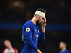Olivier Giroud is happy and rising to the challenge ahead of him at Chelsea. AFP