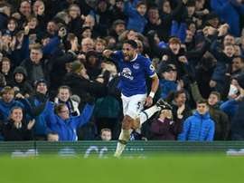 Evertons English-born Welsh defender Ashley Williams celebrates scoring his teams second goal during the English Premier League football match between Everton and Arsenal at Goodison Park in Liverpool, north west England on December 13, 2016