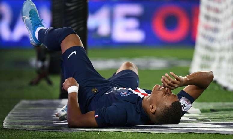 Kylian Mbappé reagiu à confirmação de sua ausência na partida contra o Real Madrid. AFP