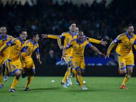 Tigres forward Andre-Pierre Gignac (R) celebrates with teammates after defeating the Pumas in penalties during their Mexican Apertura match on December 13, 2015 in Mexico City